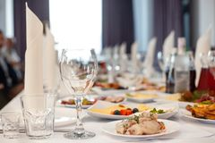 The served festive table is covered with a white tablecloth royalty free stock photography
