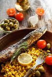 Served fish with vegetables in a plate Royalty Free Stock Images