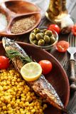 Served fish with vegetables in a plate Royalty Free Stock Photos