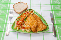 Served fried chicken breast and french fries with ketchup and cu Royalty Free Stock Images