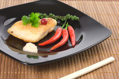 Served fried fish with chili pepper. And horseradish souce stock photo