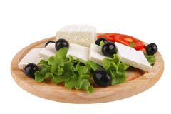 Served goat cheese with vegetables Royalty Free Stock Image