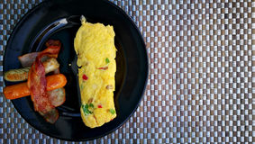 Served healthy protein breakfast with sausage and omelet on black plate. Stock Photography