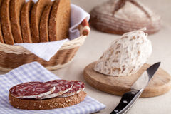 Served kitchen table, sandwich, salami, bread Royalty Free Stock Photography