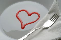 Served with love. Simple cover, made out of a heart shape on a plate Royalty Free Stock Images