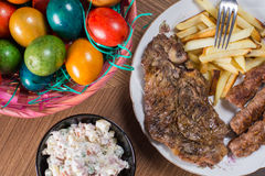 Served lunch on the table with meat and Easter eggs Royalty Free Stock Images