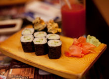 Served maki rolls on wooden plate Stock Images