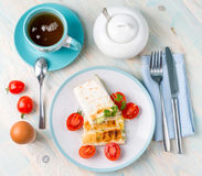 Served meal of sandwich, egg, tea, topview Stock Images