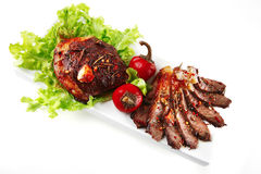 Served meat on ceramic plate Stock Photography
