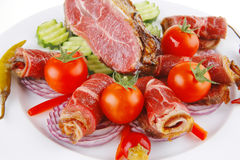 Served meat chunk with rolls  on Royalty Free Stock Image