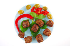 Served meat cutlets with basil Royalty Free Stock Photos