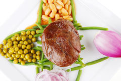 Served meat medalion on beans Stock Image