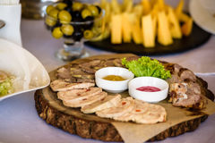 Served meat platter. Meat platter lay on wedding table well served stock photo