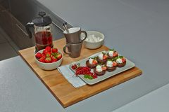 Served Mini Chocolate brownie with ice cream, tea and strawberry. Royalty Free Stock Photo