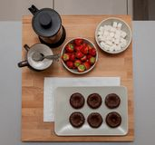 Served Mini Chocolate brownie with tea and strawberry, top view. royalty free stock photography