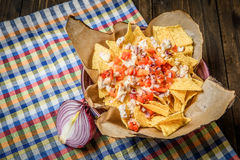 Served nachos with red onion Royalty Free Stock Photos