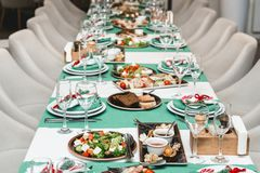 Served New Year or Christmas table closeup. Luxury restaurant. Green colours Stock Images