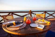 Served open air table on the porch at sunset Stock Images