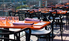Served outdoor tables in modern restaurant Royalty Free Stock Photos