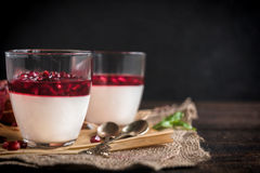 Served panna cotta with pomegranate Stock Photo