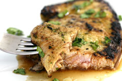 Served piece of tuna steak with greenery and dinnerware Royalty Free Stock Photos