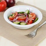 Served plate with mix salad from tomatoes and cucumbers Royalty Free Stock Photo