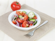 Served plate with mix salad from tomatoes and cucumbers Stock Photography