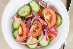 Served plate with mix salad from tomatoes and cucumbers Royalty Free Stock Photos