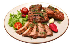 Served roasted beef on color dish Stock Images