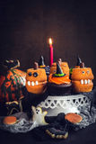 Scary Halloween cup cakes. Served scary Halloween cup cakes,selective focus Royalty Free Stock Images