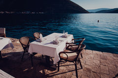 Served scenic cafe table near the sea Stock Photography