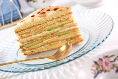 Served slice of fruit layer cake. Close up royalty free stock photography