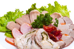 Served with sliced meat on a white plate. On a white background Royalty Free Stock Photo