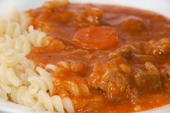 Served stew with meat and macaroni Stock Photography