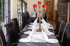 Served table. The served table with a candlestick in the centre in a restaurant interior Stock Photography