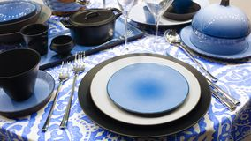 Served table with blue dishes on a blue white tablecloth Royalty Free Stock Photos