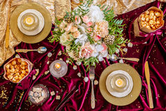 Served table with bouquet and candles Stock Photography