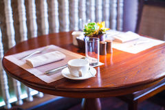 Served table for breakfast in luxury hotel with Royalty Free Stock Photo