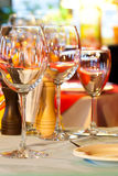 Served table charger. Wine glasses, plate and cutlery. Stock Photo