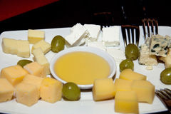 Served table with cheese assortment plate Royalty Free Stock Photo