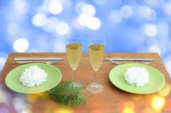 Served table for Christmas with glasses of champagne. stock photo