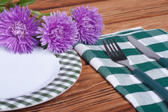 Served table decorated with asters Royalty Free Stock Photos