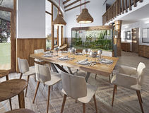 Served table for eight in the dining room in the loft with high Stock Photography