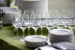 Served table with empty glasses and plates Royalty Free Stock Photo