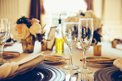 Served table for the event. White tablecloth and restaurant cutlery, dish, plate, glass, bread Stock Photo