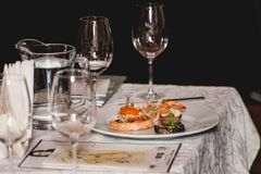 Served table for food and wine tasting. Snacks with shrimp, fish fillets, Spain tapas recipe food pintxos. Sweet snack with peach Stock Photo