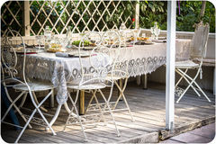 Served table for a garden-party. White garden furniture. treating for guests. family dinner Royalty Free Stock Photography