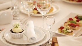 Served table. Glasses on the table. Banqueting hall. Banquet in the restaurant. Delicious food on banquet table at stock video