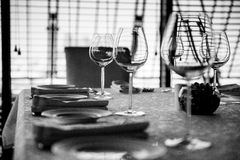 Served table with glasses. Black and white image Royalty Free Stock Photography