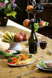 Served table with meal fruit and wine Royalty Free Stock Images